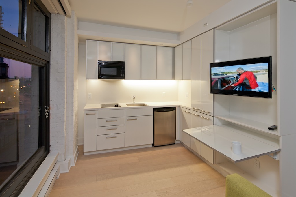 the-janion-kitchen-and-work-space-flat-screen-tv